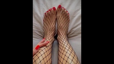 My Feet with Red Nails in Fishnets