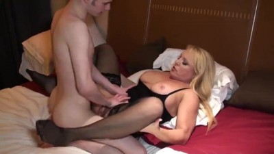 Busty Blonde Milf and Young Boy Share Bed